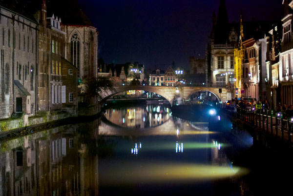 Photo of a canal and bridge in Ghent at night