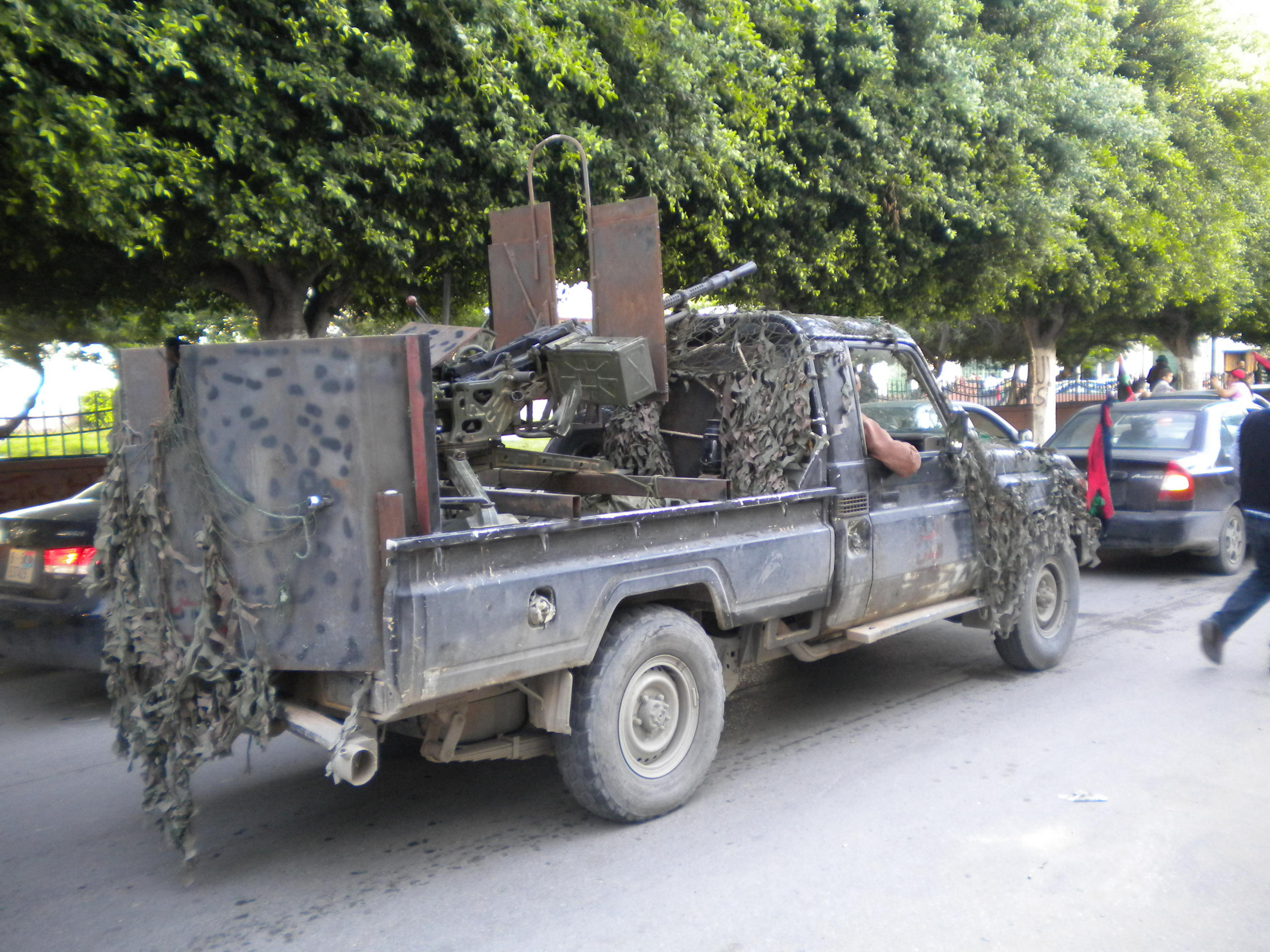 A 4x4 fitted with armour plates and heavy artillery