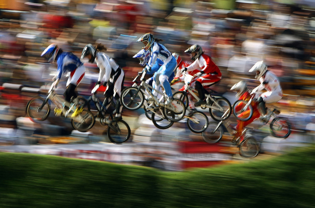 BEIJING - AUGUST 22: Competitor's race in the Women's BMX semifinal run held at the Laoshan Bicycle Moto Cross Venue during Day 14 of the Beijing 2008 Olympic Games on August 22, 2008 in Beijing, China. (Photo by Shaun Botterill/Getty Images)