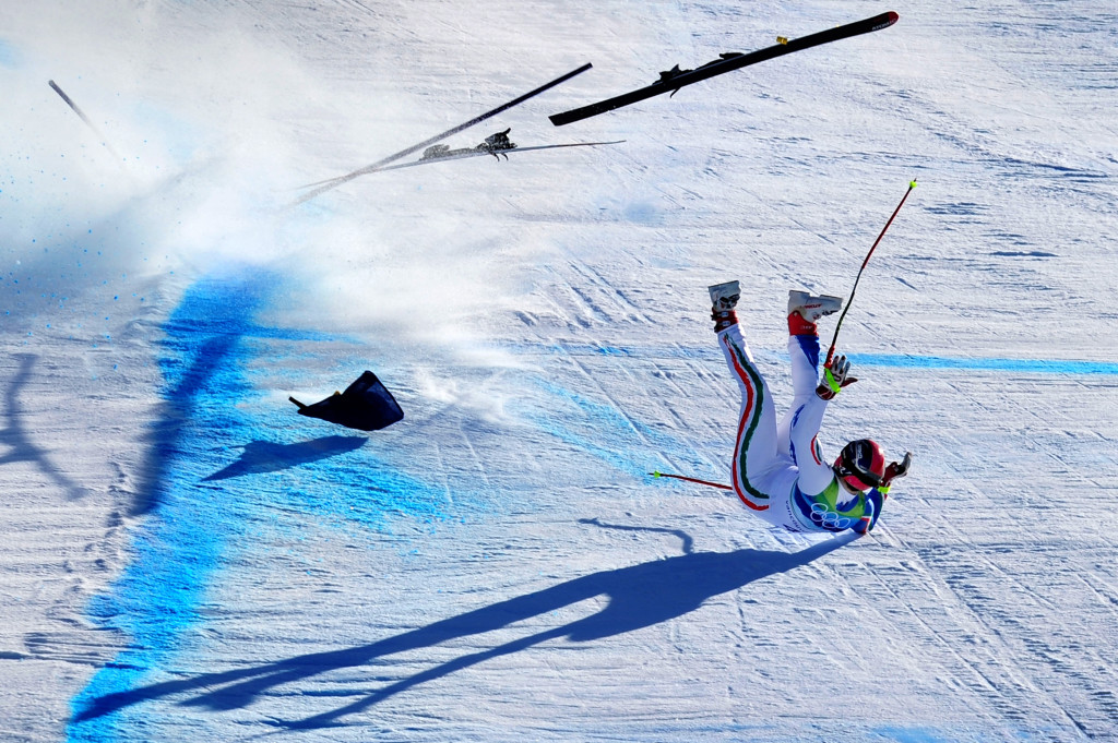 WHISTLER, BC - FEBRUARY 19: Peter Fill of Italy crashes at the last gate in the men's alpine skiing Super-G on day 8 of the Vancouver 2010 Winter Olympics at Whistler Creekside on February 19, 2010 in Whistler, Canada. (Photo by Clive Mason/Getty Images)