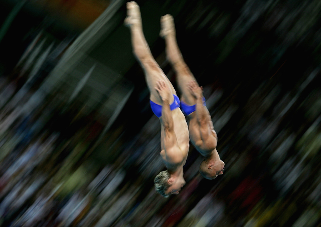 ATHENS - AUGUST 14: Peter Waterfield and Leon Taylor (L) of Great Britain compete in the men's synchronised diving 10 metre platform event on August 14, 2004 during the Athens 2004 Summer Olympic Games at the Aquatic Centre Indoor Pool at the Olympic Sports Complex in Athens, Greece.(Photo by Shaun Botterill/Getty Images)