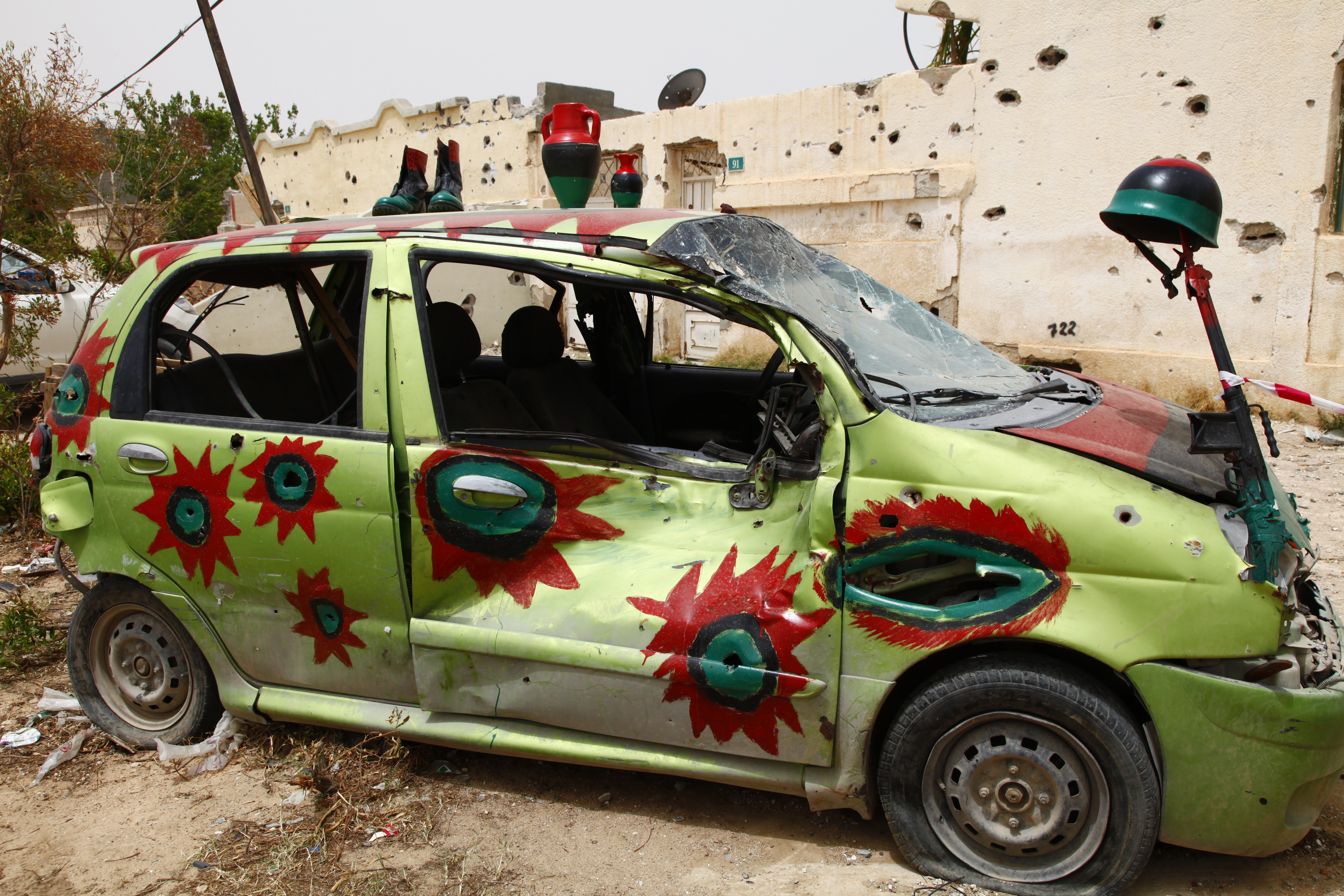 A war car painted with colours of the Libyan flag, Misrata, 2011 Credit: Flickr/ mojomogwai