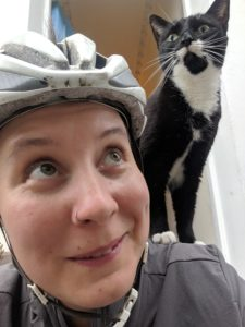 Chirps the cat riding on Liz Dodd's shoulder